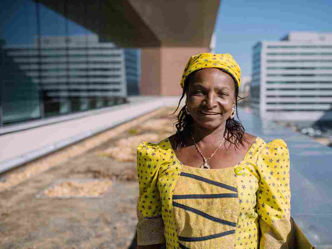 """Monica Maigari, a Female Food Heroes contestant from Nigeria, is visiting Washington, D.C., for the first time on a trip sponsored by Oxfam. She says NPR's rooftop garden, where she is pictured, is """"great for carrots and tomatoes."""""""