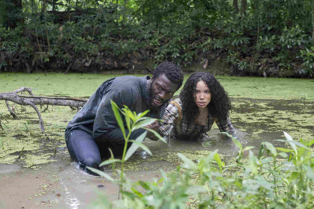 """Aldis Hodge, pictured above with Jurnee Smollett-Bell, plays Noah, the leader of the underground resistance. He says the show's impact stays with him even after the cameras are off: """"There's no way that you can come from set without taking a little piece of that with you,"""" he says."""