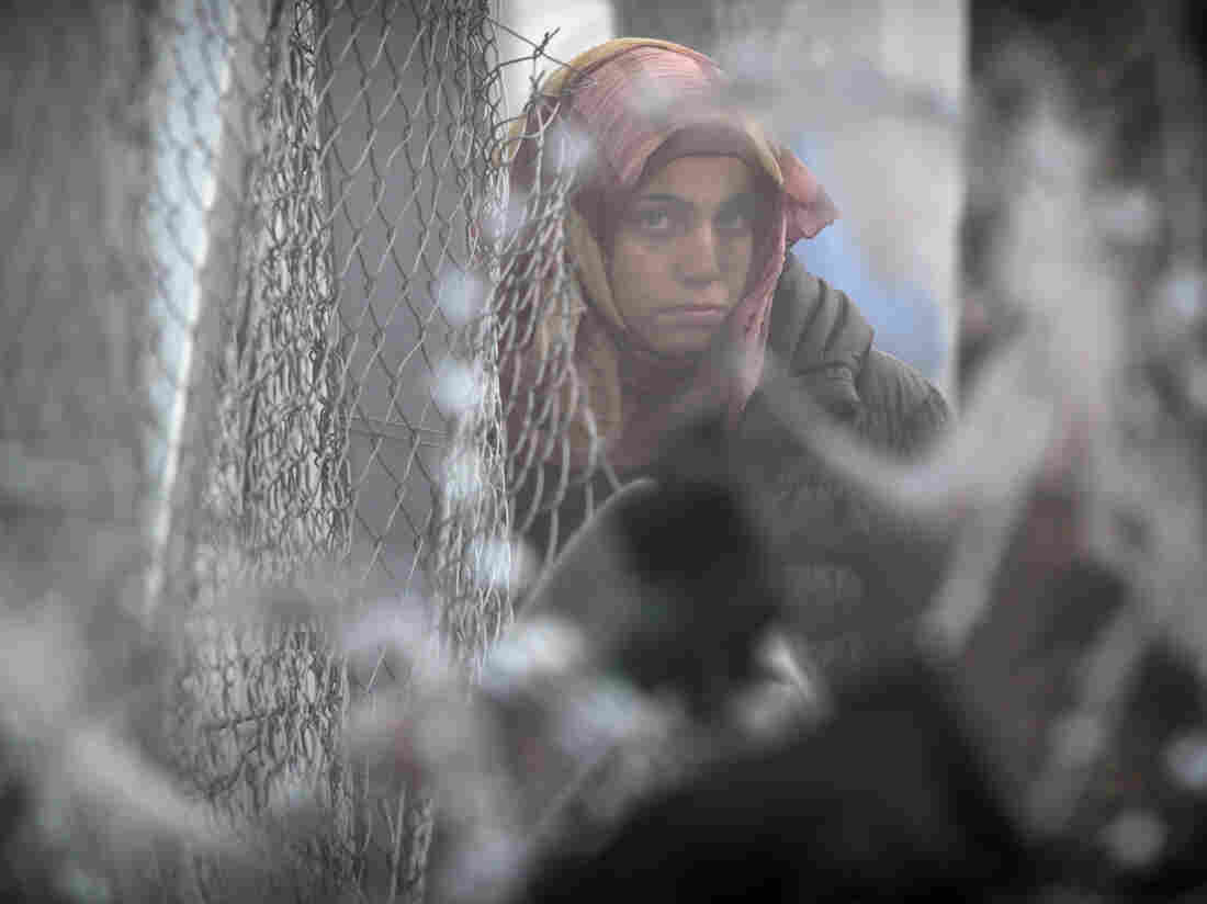 A migrant woman pictured in the northern Greek border station of Idomeni, on March 8. At least 14,000 people are stranded on the outskirts of the village as EU leaders try to control migrants entering Europe through the Balkan countries.