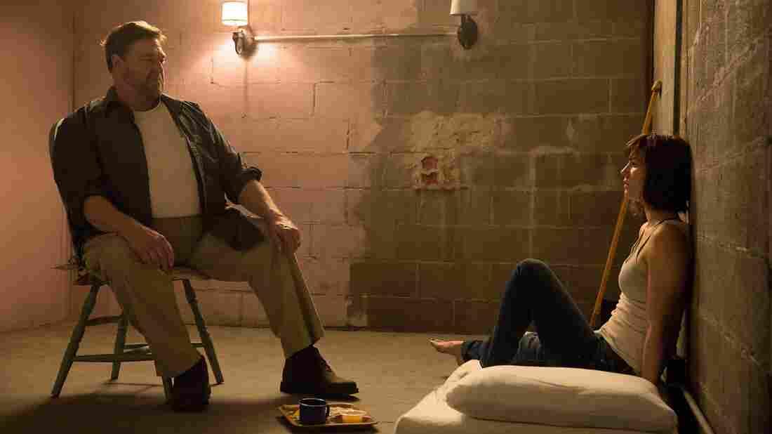 John Goodman as Howard; Mary Elizabeth Winstead as Michelle in 10 Cloverfield Lane.