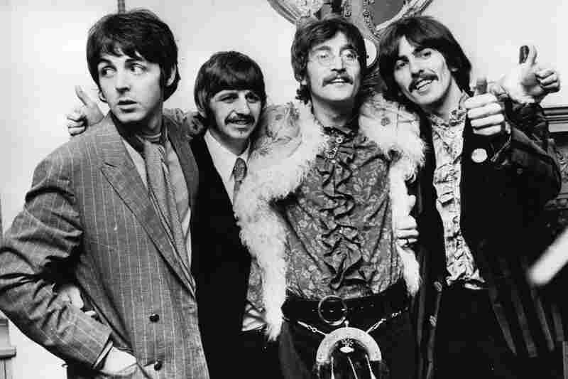 The Beatles celebrate the completion of Sgt. Pepper's Lonely Hearts Club Band in 1967. During the 1960s, Martin was their closest collaborator, producing almost all of the Beatles' music, playing piano with them, writing their orchestral arrangements and figuring out how to turn John Lennon and Paul McCartney's wilder ideas into records.