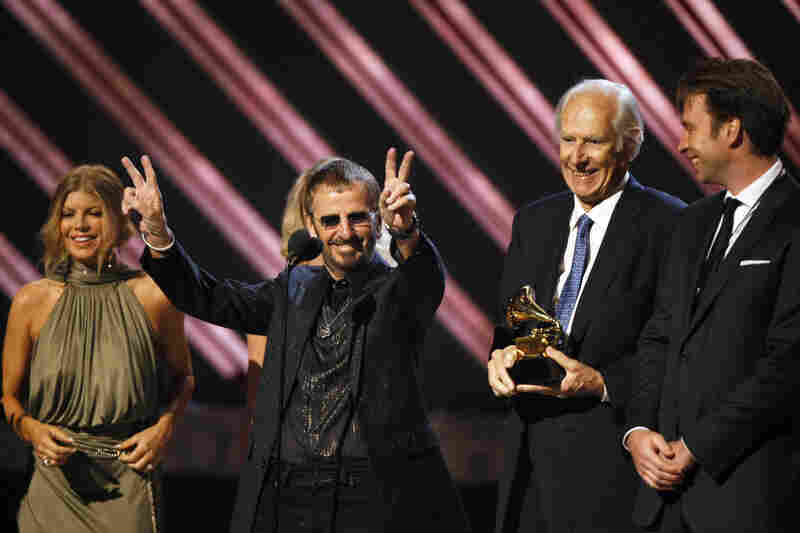 Ringo Starr celebrates as Martin holds the trophy for best compilation soundtrack album at the Grammy Awards in 2008.