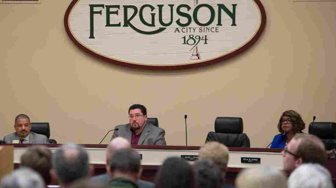 Mayor James Knowles (center) and members of the Ferguson City Council listen to citizens speak during a council meeting Tuesday.