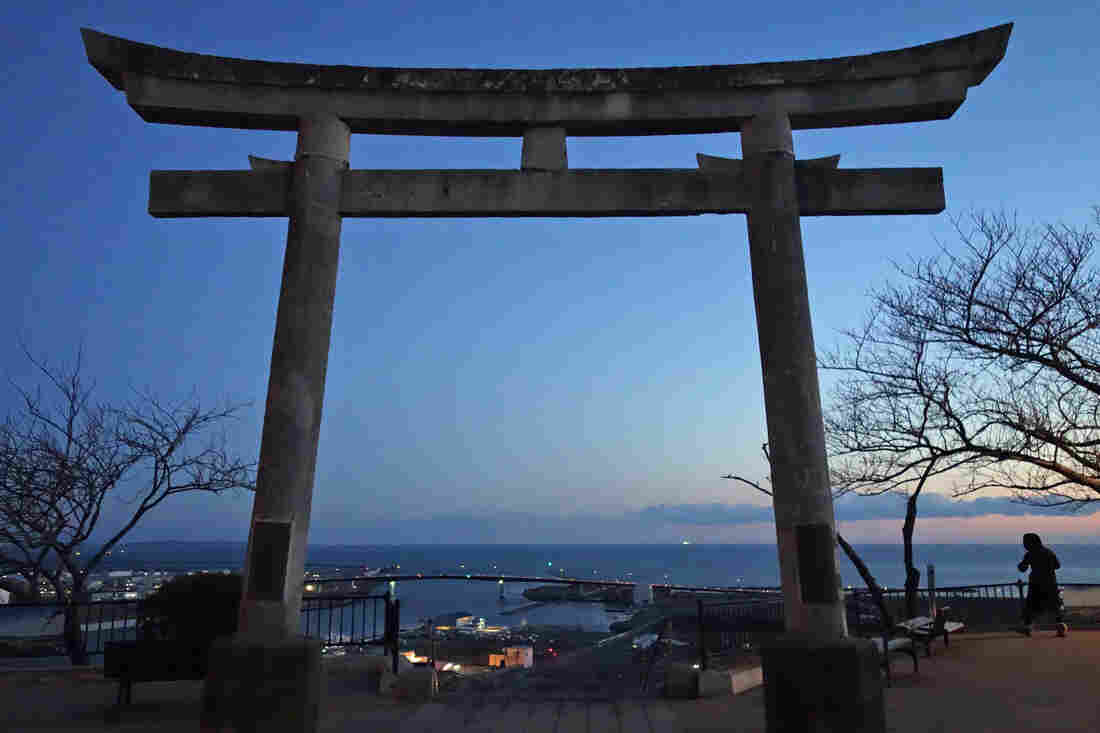 A Shinto Torii gate sits atop a hill in Ishinomaki, where 3,700 drowned in the 2011 tsunami. Many fled to the hilltop to survive.