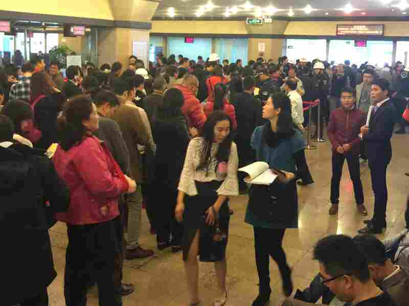 At the government's real estate transaction center in Shanghai's Baoshan district, hundreds of people show up every day to submit paperwork for homes they've just purchased.