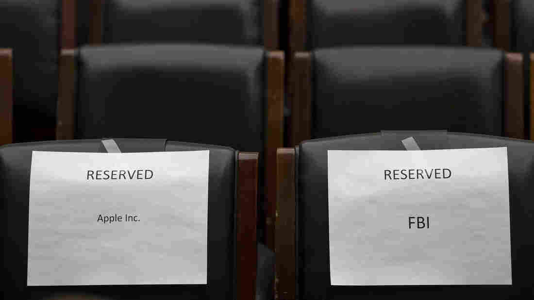 Seats are reserved for Apple and FBI at a House Judiciary Committee hearing this month. Apple and the government are fighting over whether the company needs to make it possible for investigators to read data on the encrypted iPhone used by San Bernardino shooter Syed Rizwan Farook.