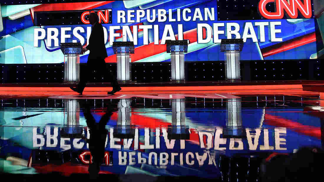A worker walks across the stage as CNN prepares for the Republican Presidential Debate Thursday in Miami, Florida.