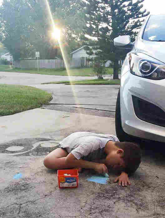 Ryan Torres, drawing in his driveway, recently went to the ER at Nemours Children's Hospital in Orlando.
