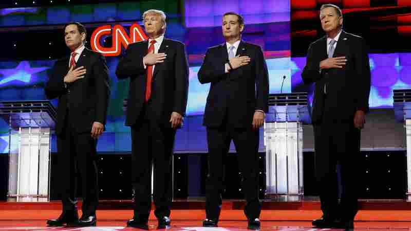 Republican presidential candidates, Sen. Marco Rubio, R-Fla., left, Donald Trump, Sen. Ted Cruz, R-Texas, and Ohio Gov. John Kasich, right, stand together during the signing of the National Anthem, before the start of the Republican presidential debate Thursday in Miami.