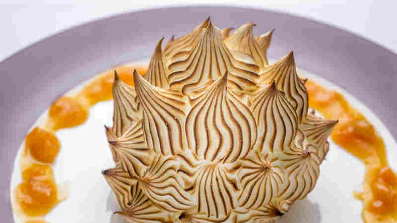 This version of Baked Alaska at Delmonico's restaurant in New York City stays true to the original: a walnut sponge cake layered with apricot compote and banana gelato, covered with torched meringue.