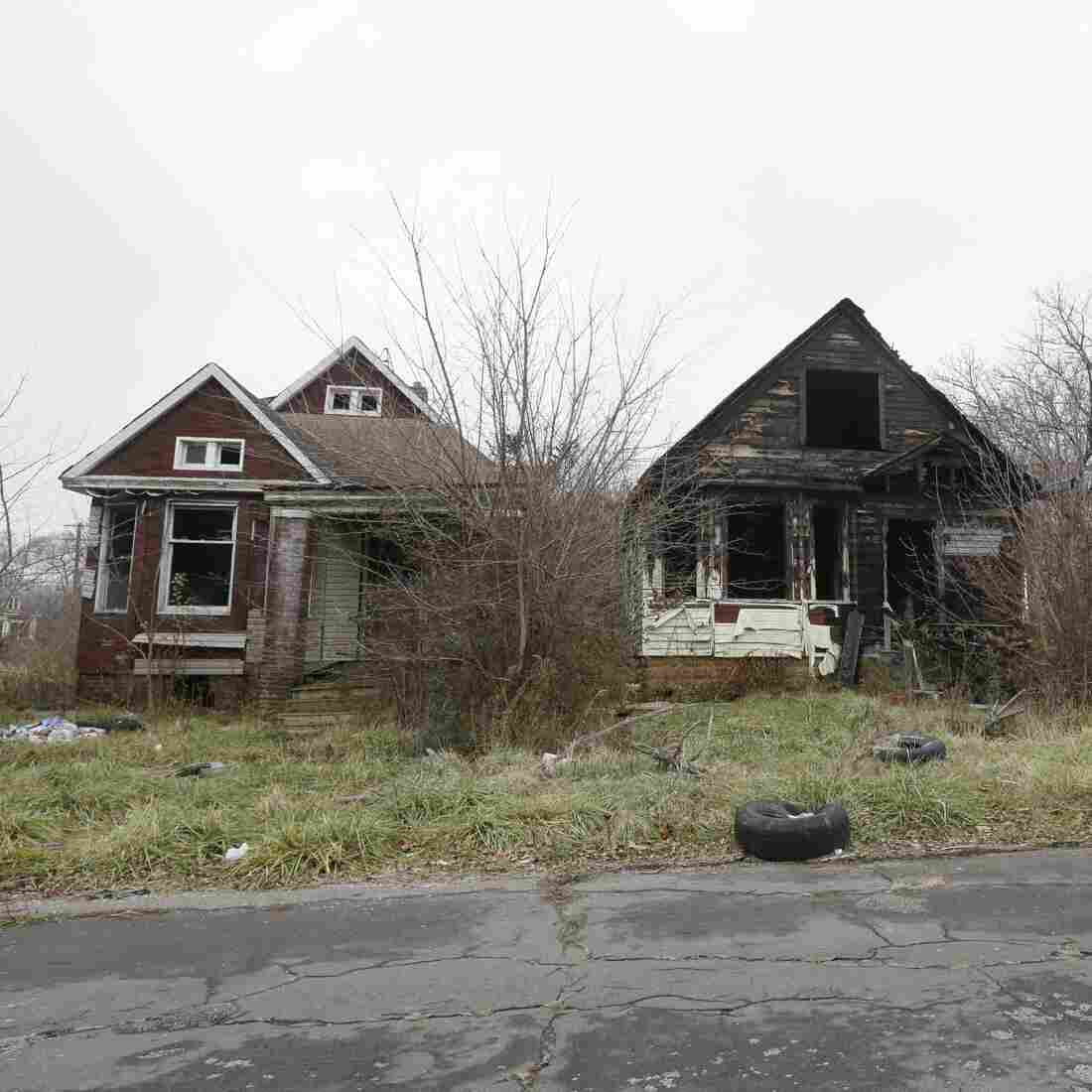 Abandoned homes molder on the east side of Detroit last year.