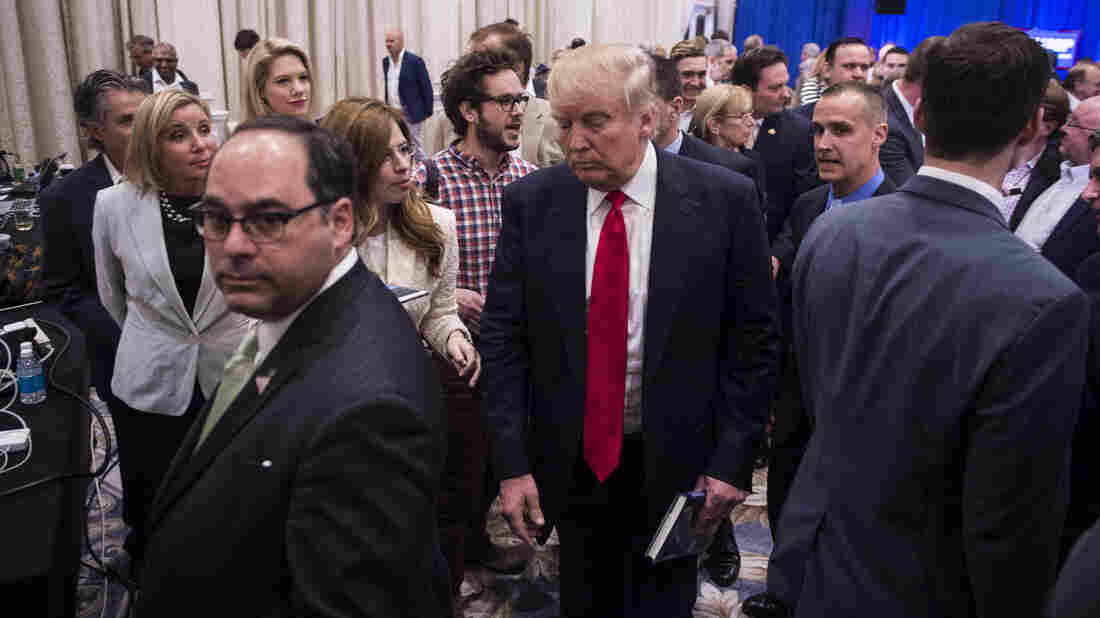 """Republican presidential candidate Donald Trump at Tuesday's press conference in Jupiter, Fla., where Breitbart reporter Michelle Fields, seen to the left of Trump, says """"someone had grabbed me tightly by the arm and yanked me down."""""""