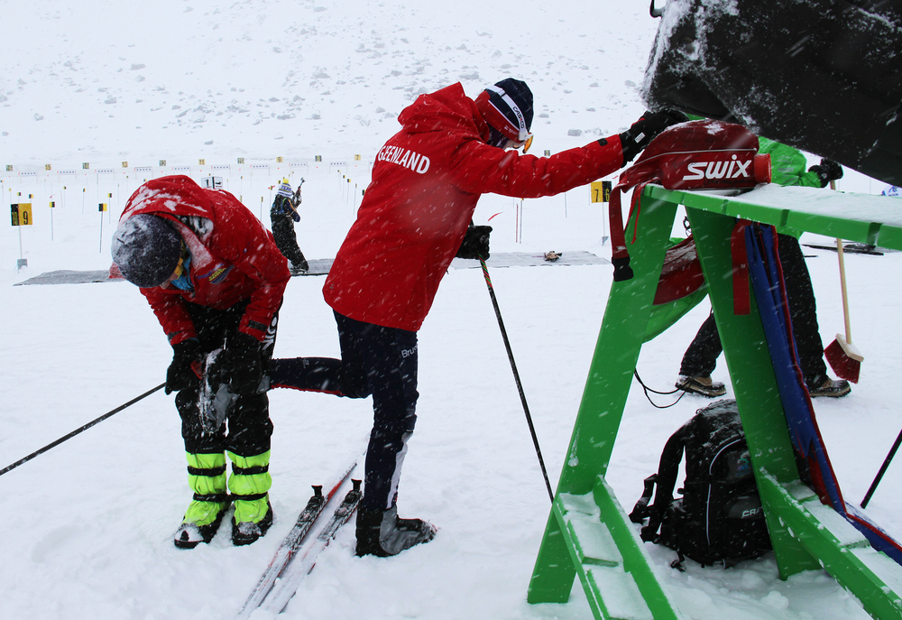 Greenlandic biathlon competitor Ukaleq Slettemark, 14, gets help cleaning her ski bindings from Uiloq Slettemark, her mother and coach,pre-race at the Arctic Winter Games. Ukaleq won in her age group.