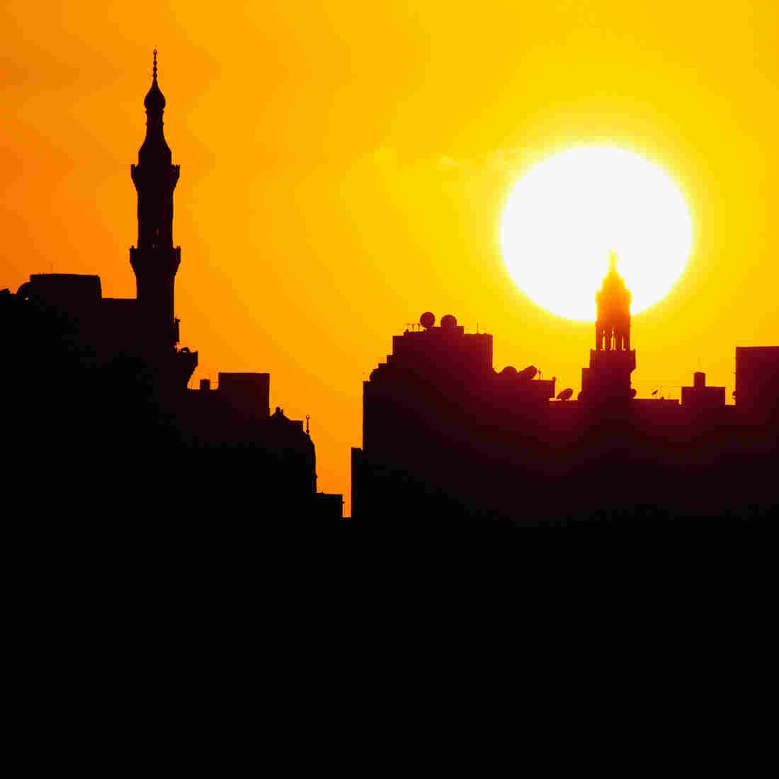 The sun sets over Alexandria, Egypt. The Brits brought daylight saving time to Egypt, but the country is currently DST-free.