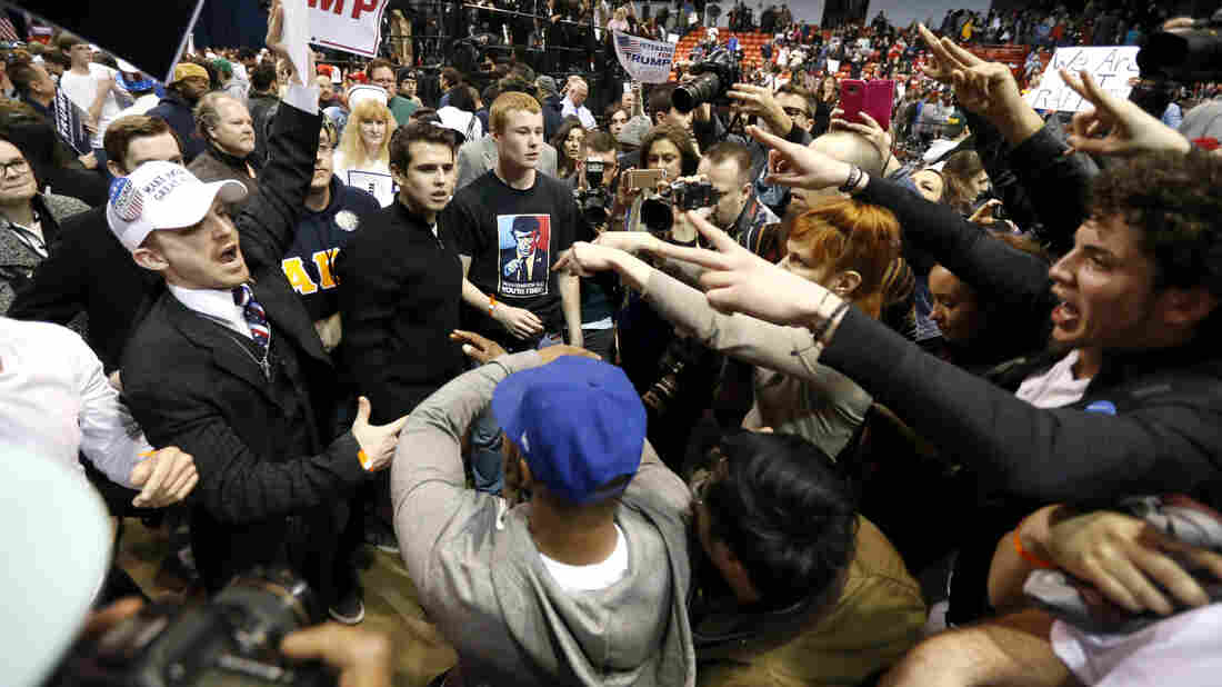 Supporters of Republican presidential candidate Donald Trump (left) face off with protesters after a rally on the campus of the University of Illinois-Chicago was cancelled due to security concerns on Friday in Chicago.