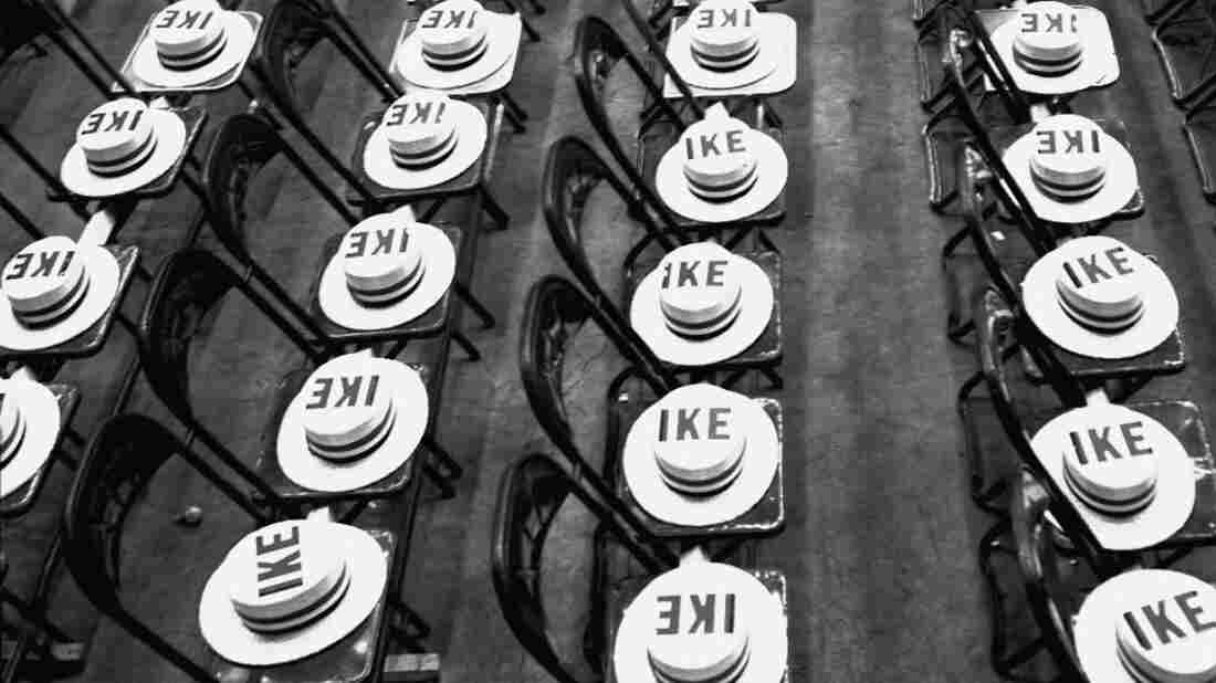 "Moments before a night session of the Republican National Convention in Chicago in 1952, the seats of New York delegates were covered with ""Ike"" straw hats for Dwight Eisenhower."