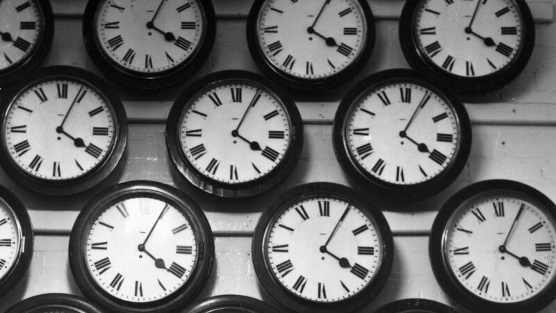 A photo from the '60s shows a collection of clocks used for timing Civil Service exams.