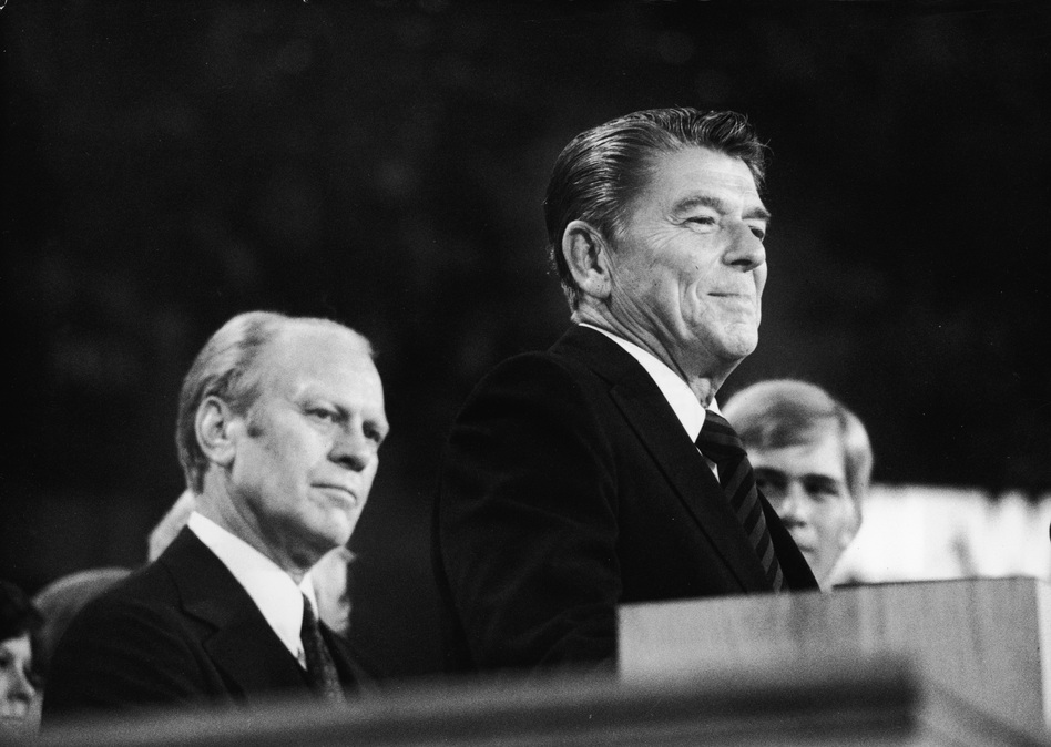 Incumbent Gerald Ford (left) listens as Gov. Ronald Reagan delivers a closing speech at the 1976 Republican National Convention in Kansas City, Mo.