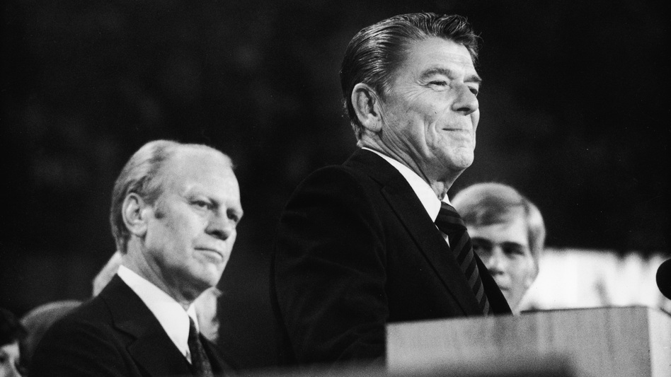 Incumbent Gerald Ford (left) listens as Gov. Ronald Reagan delivers a closing speech at the 1976 Republican National Convention in Kansas City, Mo. (Getty Images)