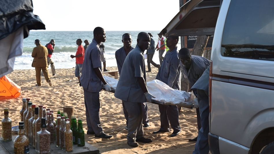"Employees load a body into a van after heavily-armed gunmen opened fire in the Ivory Coast resort town of Grand-Bassam, leaving bodies strewn on the beach, killing more than a dozen people. The assailants, who were ""heavily armed and wearing balaclavas, fired at guests at the L'Etoile du Sud, a large hotel which was full of expats in the current heatwave,"" a witness told AFP. (Sia Kambou/AFP/Getty Images)"