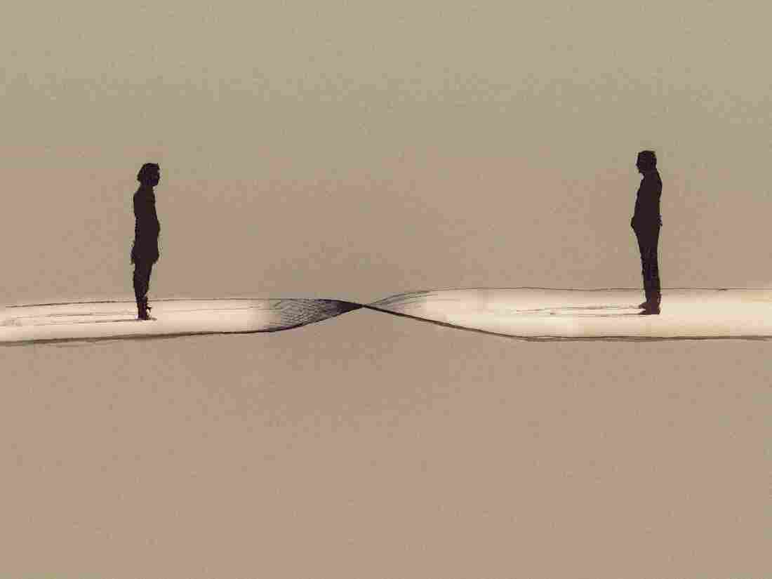 Man and woman separated by twisted path. Gary Waters/Ikon Images/Corbis
