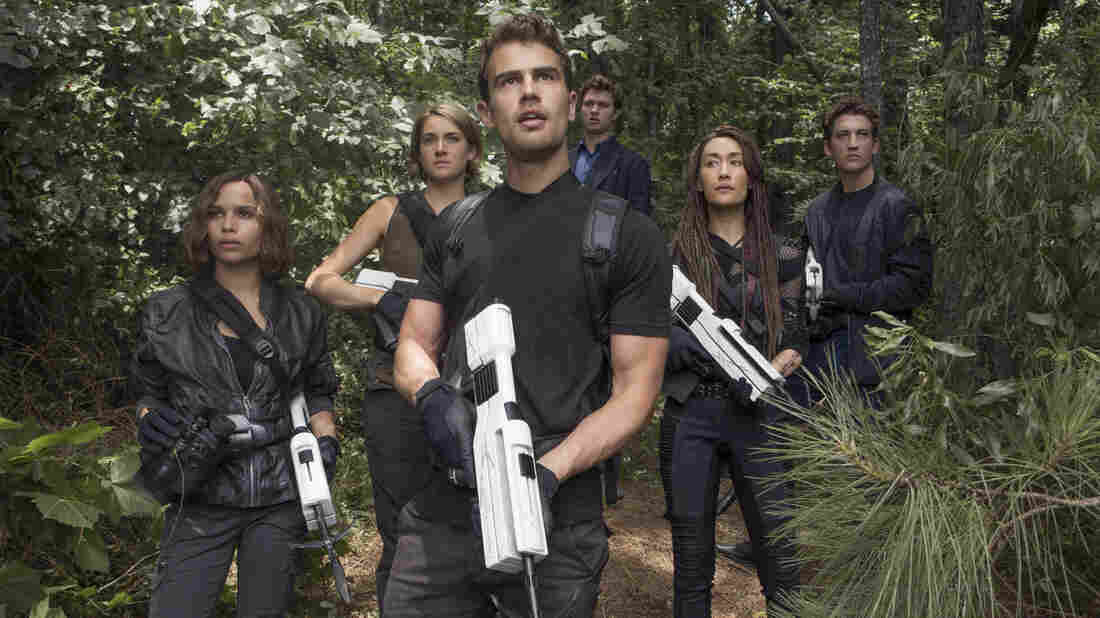From left to right: Christina (Zoe Kravitz), Tris (Shailene Woodley), Four (Theo James), Caleb (Ansel Elgort), Tori (Maggie Q) and Peter (Miles Teller) in The Divergent Series: Allegiant.