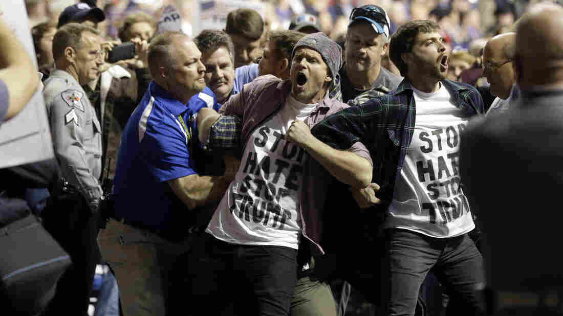Protesters are removed as Republican presidential candidate Donald Trump speaks during a campaign rally in Fayetteville, N.C., last Wednesday.