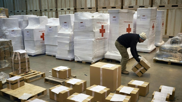 Employees prepare a convoy of four trucks transporting warm clothes and shoes to refugees in Ukraine, at the initiative of the French Red Cross, on Feb. 26 in Saint-Quentin-Fallavier, France. (AFP/Getty Images)