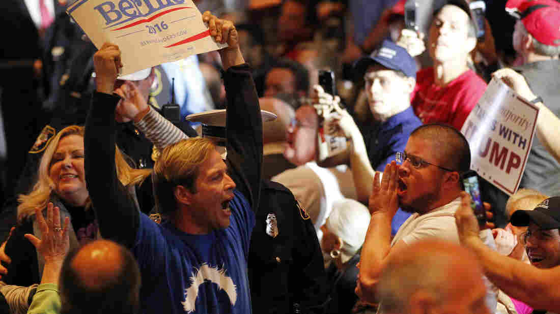 A Bernie Sanders supporter is taken out by police from a Donald Trump rally in Cincinnati on Sunday.
