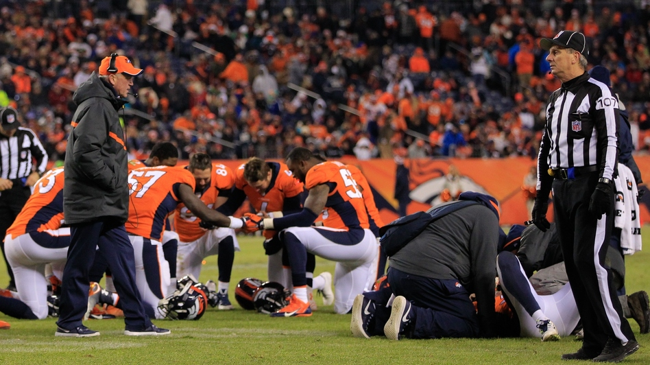 Before Monday, no NFL official had publicly acknowledged a link between football and chronic traumatic encephalopathy. Here, members of the Denver Broncos are seen after one of their teammates suffered a concussion during a game in late 2014.