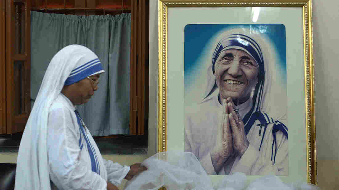 Mother Teresa will be canonized this fall, the Vatican has announced. Here, a nun of the Missionaries of Charity decorates a picture of Mother Teresa before a special prayer service in Kolkata in December.