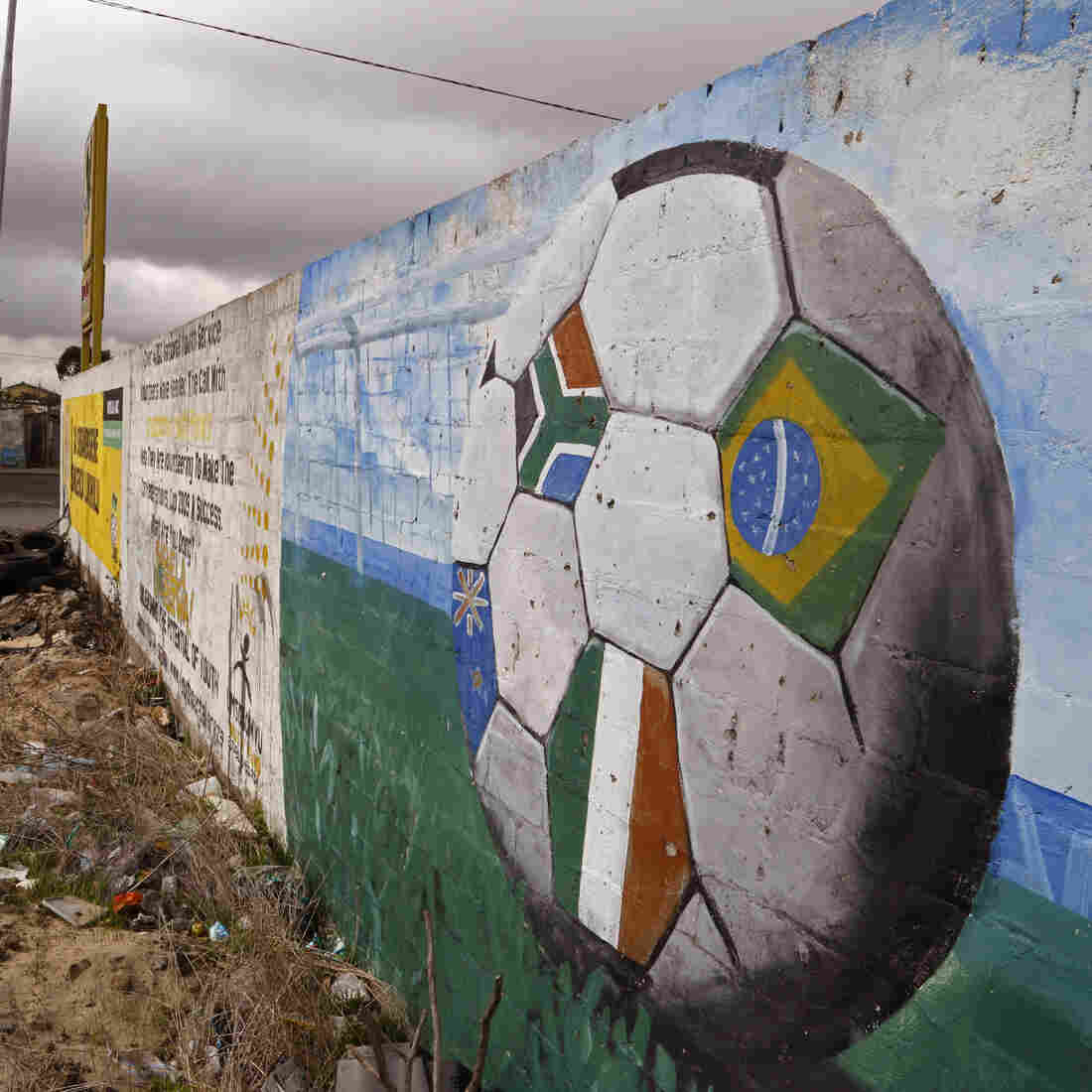 A soccer ball covered with flags is painted on a wall in the township of Khayelitsha, South Africa. The image of South Africa's 2010 World Cup has been shattered by allegations that its bid over a decade ago was boosted by bribes of more than $10 million to secure FIFA votes — allegations FIFA addressed in Wednesday's request for restitution.