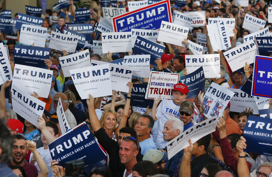 Audience members hold up signs supporting Republican presidential candidate Donald Trump during a campaign rally in Boca Raton, Fla., on Sunday. (Paul Sancya/AP)