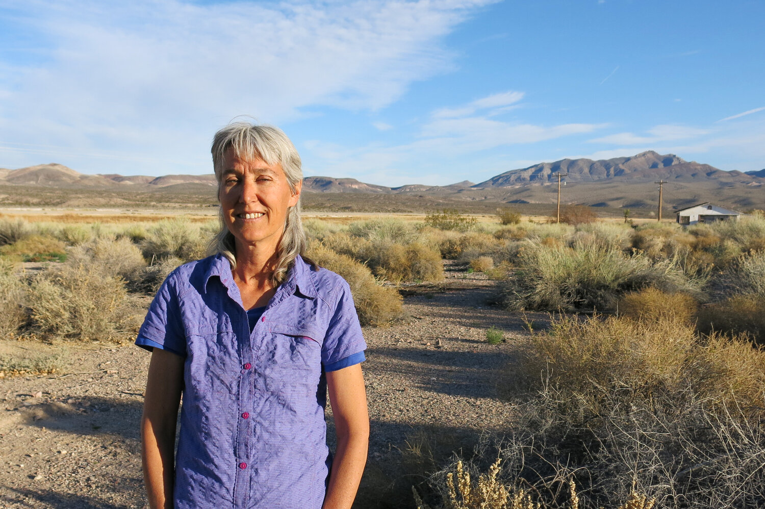 Laura Cunningham, co-founder and executive director of Basin and Range Watch stands near her home in Nevada. Her group has taken legal action against the U.S. Bureau of Land Management to learn more details about the number of bird deaths associated with Crescent Dunes Solar Energy Plant.