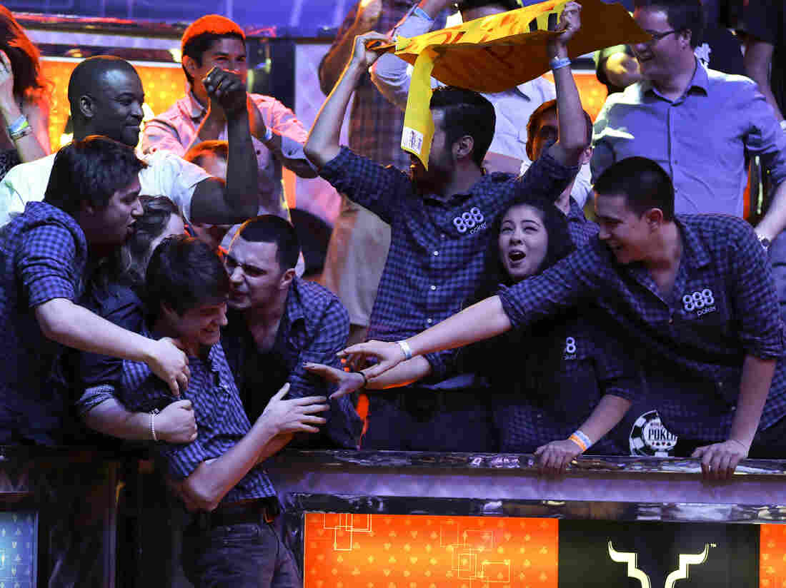 Friends congratulate Jake Balsiger during the World Series of Poker Final Table event in 2012.