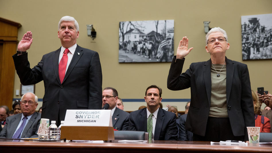 Michigan Gov. Rick Snyder and EPA Administrator Gina McCarthy are sworn in to testify before the House Oversight and Government Reform Committee hearing in Washington on Thursday. (Andrew Harnik/AP)