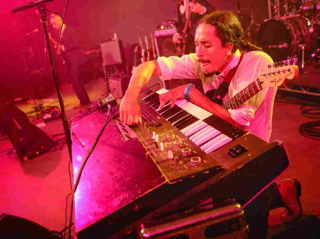 Bardo Martinez of Chicano Batman balances guitar and keys at the NPR Music SXSW showcase.
