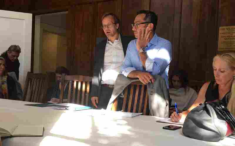 Silvio Carrillo, center, listens during a meeting with non-profit leaders.