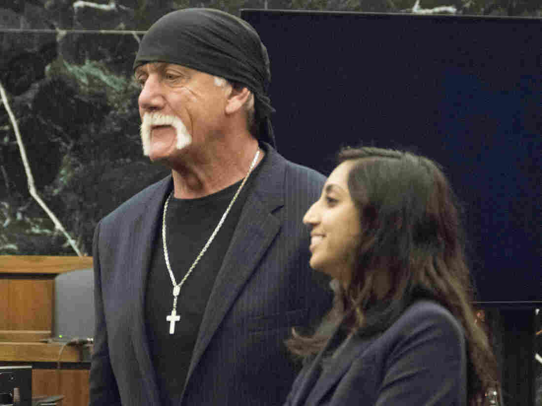 Former professional wrestler Hulk Hogan stands with one of his lawyers just after his civil suit against Gawker Media went to the jury. The panel awarded him  $115 million in damages on Friday.