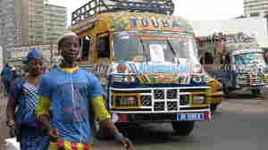 "For 50 years, the fast and cheap ""car rapide"" minibus, painted from stem to stern, has become a national symbol for Senegal."
