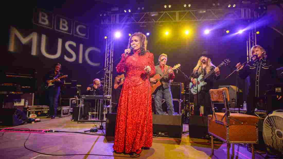 Loretta Lynn, in an iconic red dress, entranced the crowd at Stubb's BBQ.