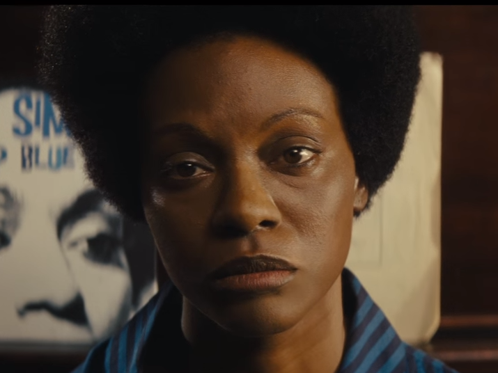 This still is from the first trailer for Nina, starring Zoe Saldana as singer Nina Simone. This image of Saldana in dark makeup and with a prosthetic nose helped reignite a controversy over skin color and casting.