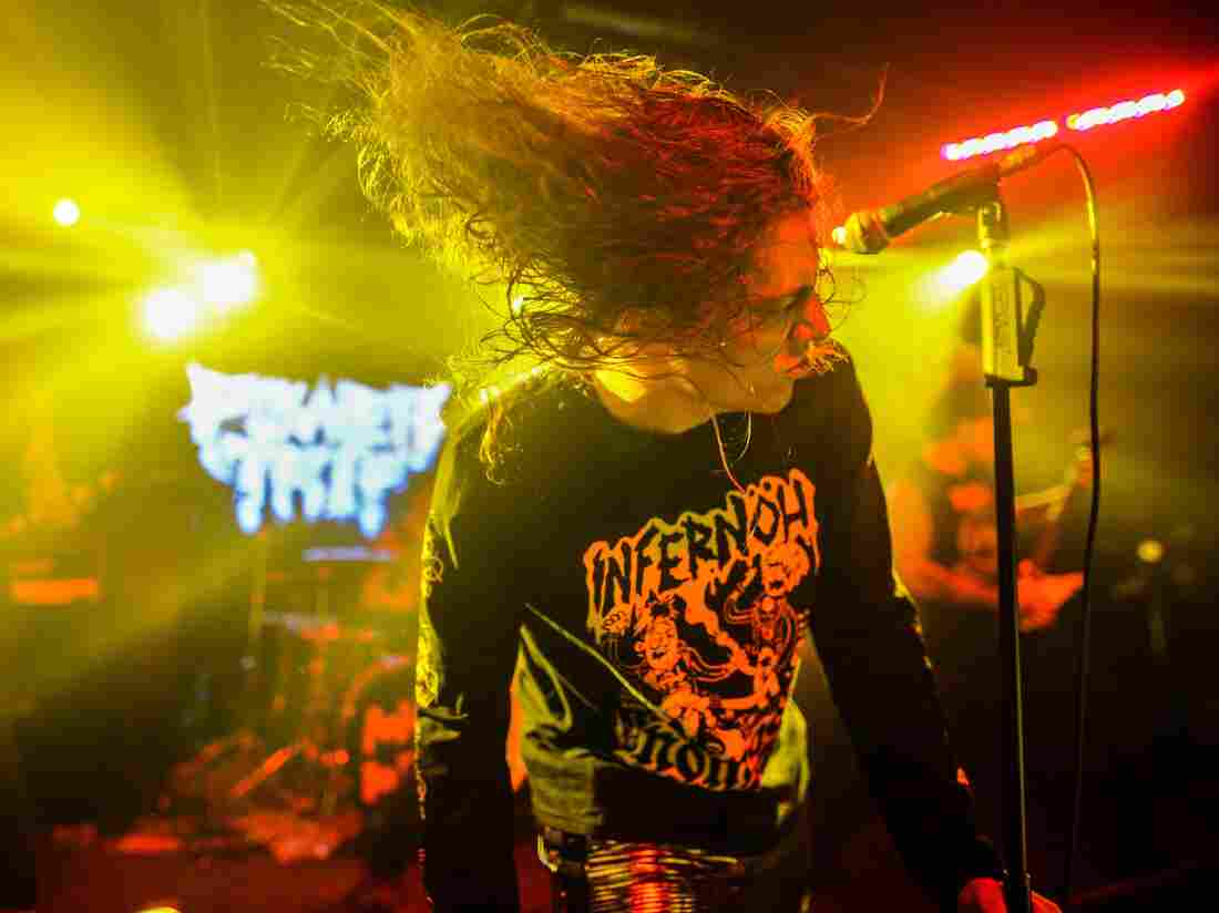 Frontman Riley Gale of Power Trip whips his hair at Empire Control Room.