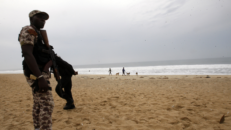 An Ivorian soldier stands guard on March 18, 2016 at the site of a jihadist shooting rampage at the beach resort of Grand Bassam. (STR/AFP/Getty Images)