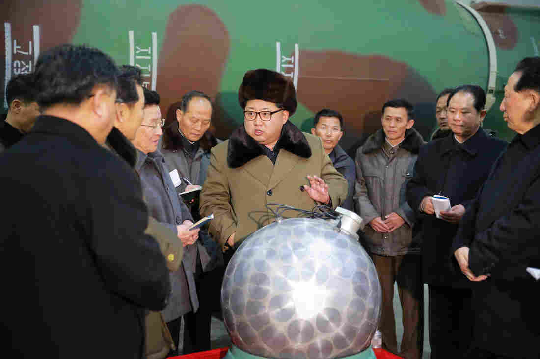 """An undated picture provided by the official Korean Central News Agency earlier this month shows North Korean leader Kim Jong Un talking with scientists and technicians. North Korea's nuclear warhead was jokingly dubbed """"the disco ball,"""" but experts say the spherical device, while likely a model, is probably based on a real nuclear weapons design."""