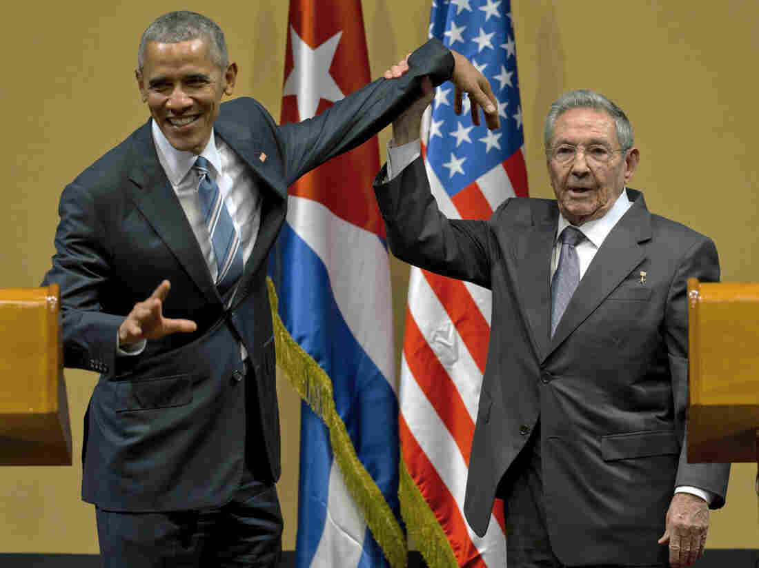 Cuban President Raul Castro tries to lift up the arm of President Obama at the conclusion of their joint news conference in Havana, Cuba, on Monday.