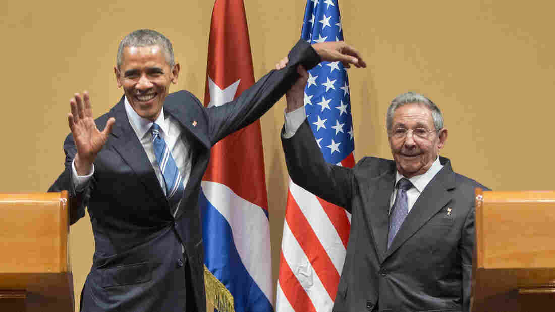 Cuban President Raúl Castro lifts up President Obama's arm at the conclusion of Monday's joint news conference at the Palace of the Revolution in Havana.