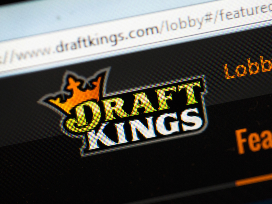 DraftKings and its rival FanDuel have agreed to suspend paid contests in New York temporarily. (Scott Olson/Getty Images)