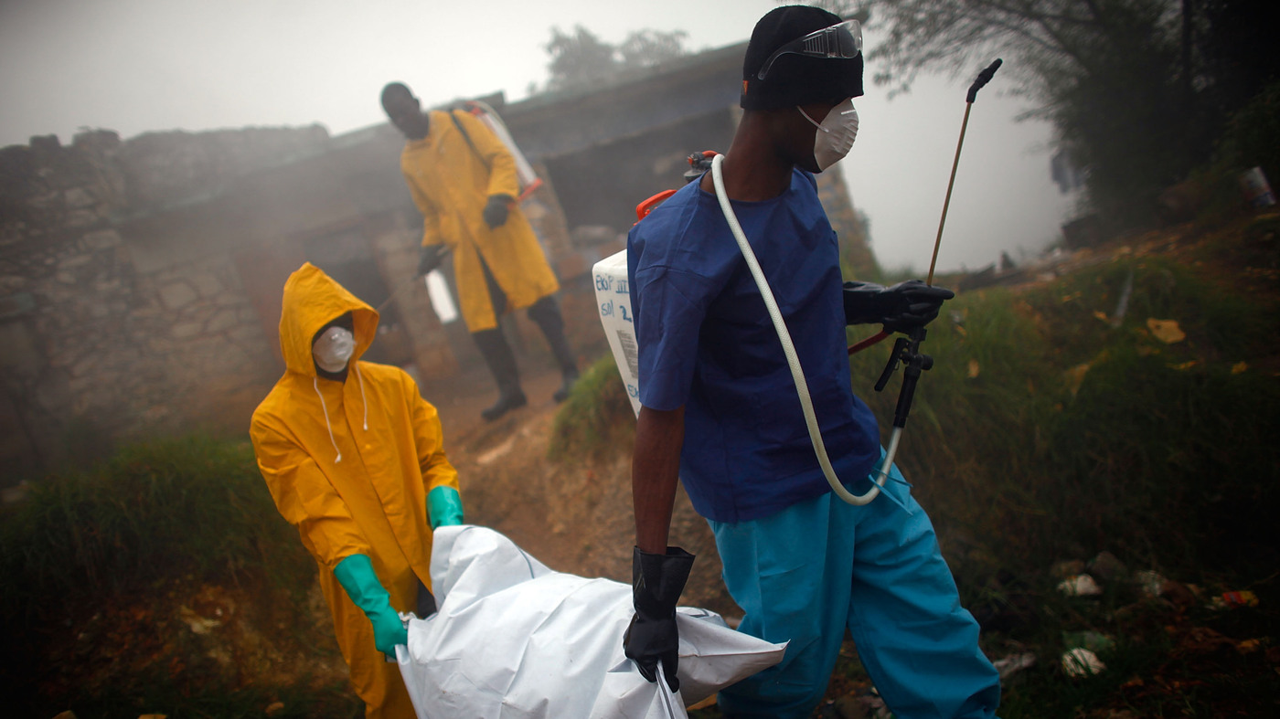 Health workers carry the body of a cholera victim in Petionville, Haiti, in February of 2011. Photo Credit: David Gilkey/NPR