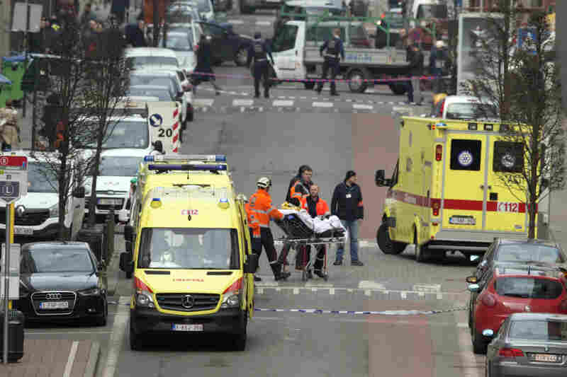 A victim is evacuated on a stretcher by emergency services after an explosion in a metro station in Brussels.
